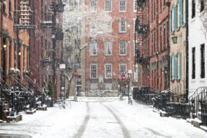 Icy sidewalks concept. Snowy winter scene on Gay Street in the Greenwich Village neighborhood of Manhattan in New York City.