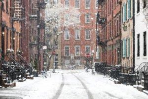 Icy sidewalks concept. Snowy winter scene on Gay Street in the Greenwich Village neighborhood of Manhattan in New York City.