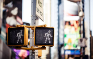 Pedestrian accidents concept. Keep walking New York traffic sign